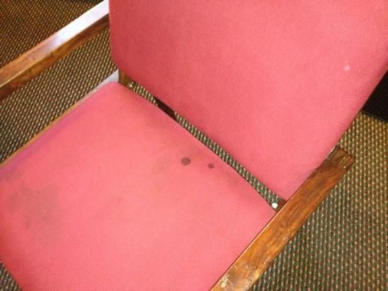 Super 8 St. Louis Airport: chair w/ stains.