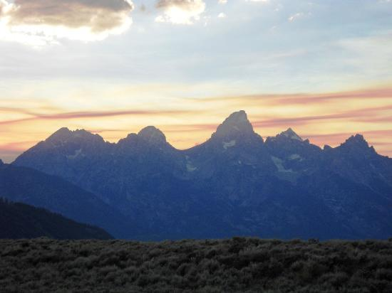 Anne Kent Cabins: View of Tetons from front porch at sunset
