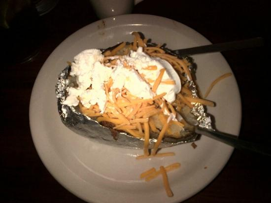 Texas Roadhouse: Brisket stuffed baked potato with cheese, sour cream and butter...the BOMB!
