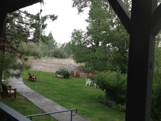 Pine Knot Guest Ranch: View from Cabin 15,partial view of grass area. Summer thunderstorm.