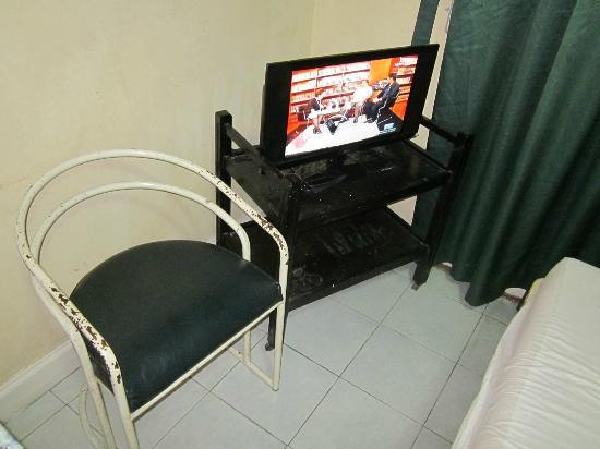 The Residence Hotel: Rusty seat and LCD TV