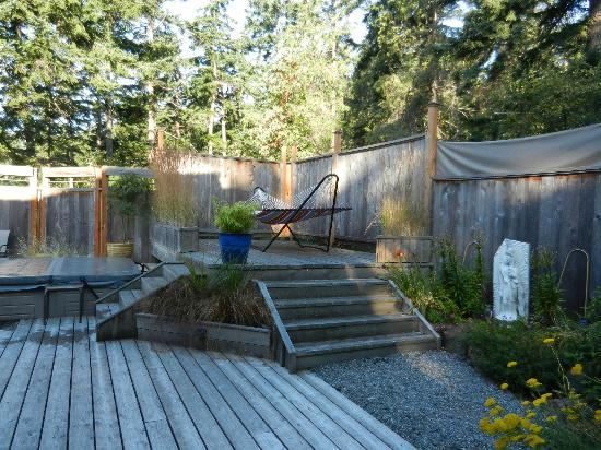 Heartwood House: The hammock in the courtyard. Hot tub to the left.