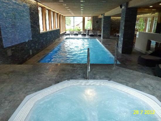 VIEW OF THE INDOOR HEATED POOL INSIDE THE SPA OF HOTEL LE FER A CHEVAL IN MEGEVE.