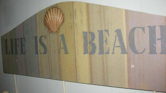 Beachside Colony: a wall plaque