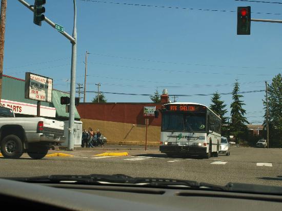 Taqueria Las Palmas: Crossing First Street on Cota Las Palmas next to bus