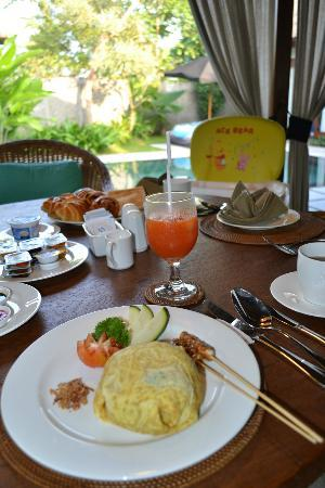 The One Villa: Egg-wrapped Indonesian Fried Rice with Papaya juice for Breakfast