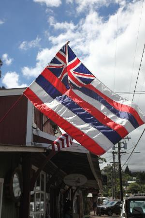 T Komoda Store & Bakery Incorporated: The Hawaii State flag waves gently in the Makawao upcountry cool breeze