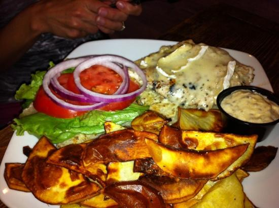 Nancy O's: Chicken and Brie burger with wedges and garlic dip.