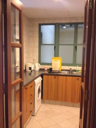 Fraser Place Robertson Walk, Singapore : kitchen in 1 bedroom suite. Front loading washing machine