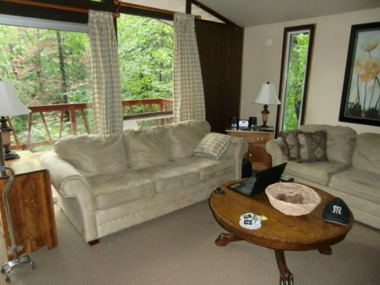 Trillium Resort and Spa: Living Room with two sofas, view of deck and semi-Cathedral Ceiling