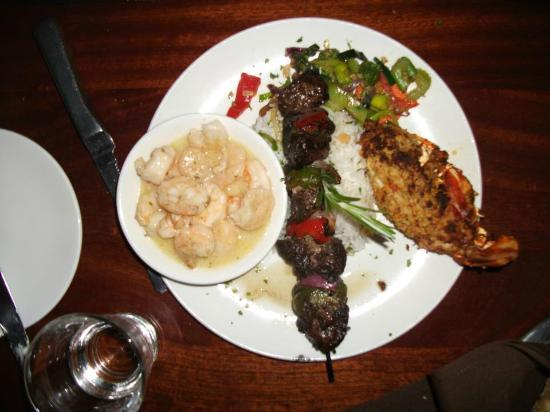 Island Way Grill: Surf & Turf Trio - stuffed lobster tail, filet mignon skewer, shrimp scampi