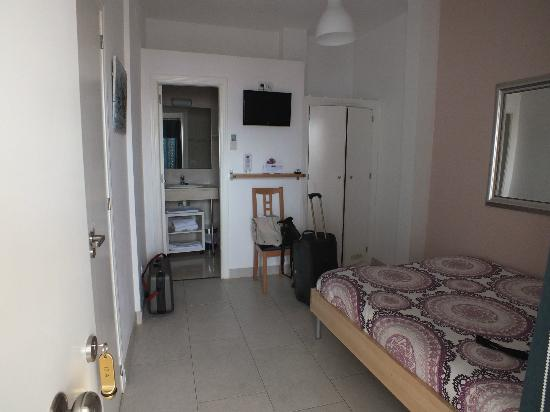 Hotel un Patio en Santa Cruz: Notre chambre donnant sur la terrasse