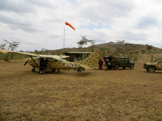 Campi ya Kanzi : The landing strip at the camp. The camp's Cessna 206 and pilot (Sarah) are first class