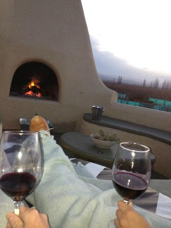 Cavas Wine Lodge: Fire and sunset with some wine on the balcony!