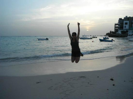 Yellow Bird Hotel: Jumping for joy on the beach in front of the Yellow Bird! :-)