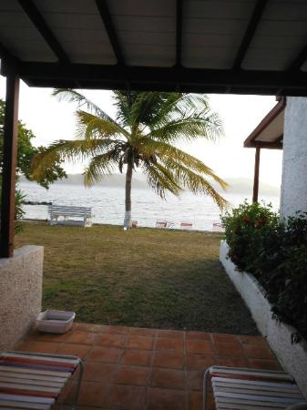 Fort Recovery Beachfront Villa & Suites Hotel: Beach is right outside patio door