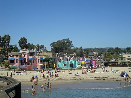 Capitola City Beach: Colorful beach houses seen from the pier