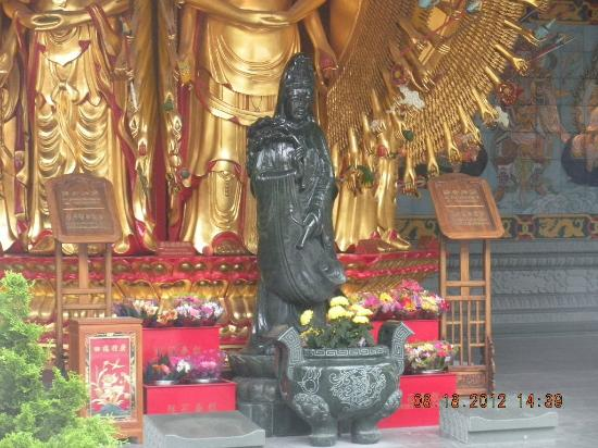 International Buddhist Society (Buddhist Temple): Buddhisattva of Compassion at Buddha's feet