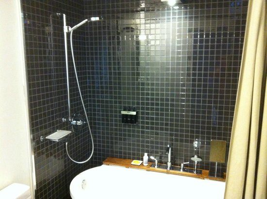 The Standard, East Village:                   Small bathroom, shower was tricky, had to pull curtain all around or water wen