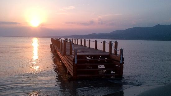Karousades, กรีซ: Sunrise over the jetty on Roda beach.