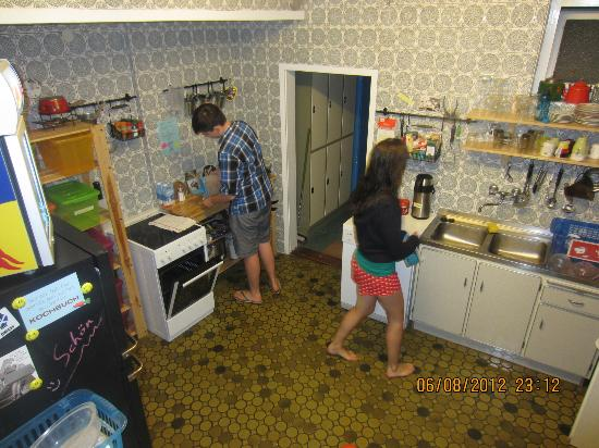 Lotte - The Backpackers: Helping ourselves to supper in the kitchen (taken from the steps that lead up to the living room