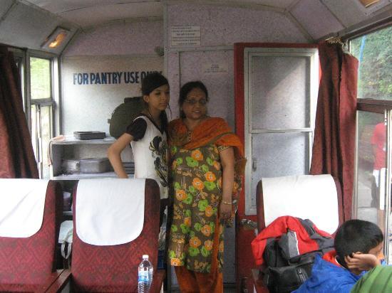 Kalka - Shimla Railway: Inside the Shivalik Express, the toilet door is right behind the lady