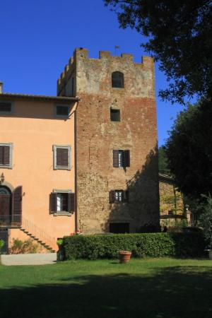 The medieval tower that is part of the Villa il Pozzo
