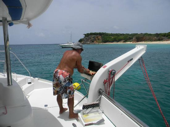 St Martin Catamarans Charters : The Captain grilling chicken kabobs