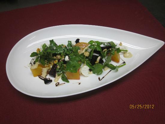 Club Grille Steak House: Red and Yellow Beet Salad,Goat Cheese,Hazelnut dressing,Watercress