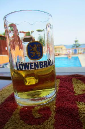 Eleni's Village: beer in the bar with a view to the pool and the sea.