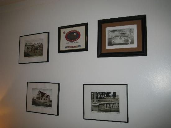 Historical Park Motel : Wall in bedroom with Lincoln Highway documents.