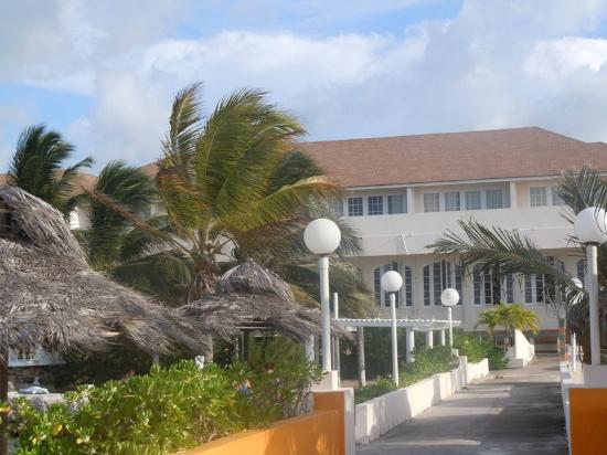 Club Ambiance: View toward the main building (and honeymoon suites) from Legends Pier Bar