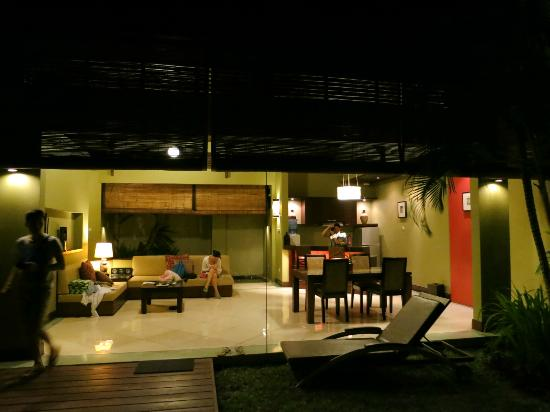 Pradha Villas: Living Room and kitchenette area at night