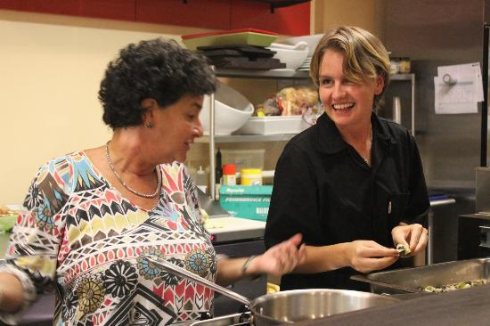 Relish Epicurea: One of the cooks getting advice from owner of Relish, Alison