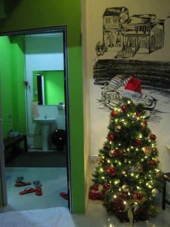 Five Stones Hostel: christmas tree next to entrance to male bathroom