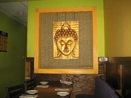 Song Kran has Buddhist-inspired decorations on the wall