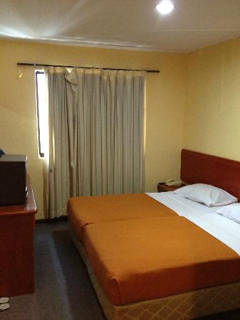 Accordian Hotel: Room facing crossroad, Room 117