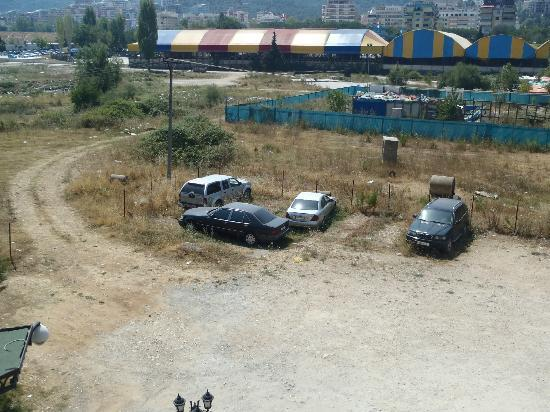 """Dinasty Hotel: The view of the """"secure parking facility"""" (dirt lot) and """"park"""" (landfill)"""