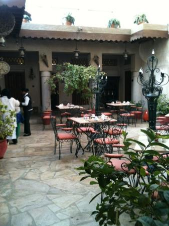 Orient Guest House: the courtyard during breakfast and tm9 is in the middle arch