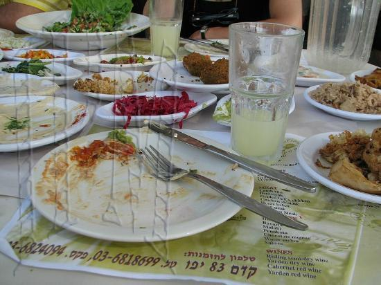 Jaffa, Israel: Sorry for the empty plates, it's just part of the salads before the main course was served.