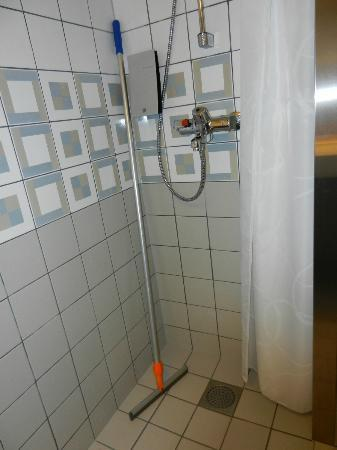 Original Sokos Hotel Vantaa: A squeegee for after shower is part of the furniture