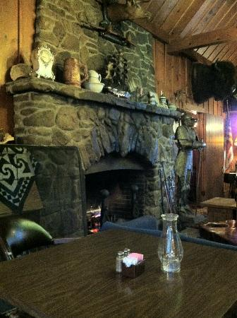 Hilltop Lodge Glamping Resort: Beautiful stone fireplace in 100 year old lodge