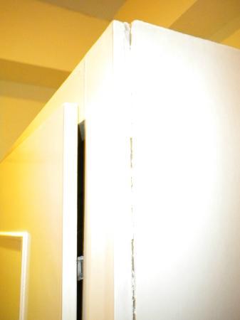 Commodore Hotel: wardrobe doors falling apart.. terrible