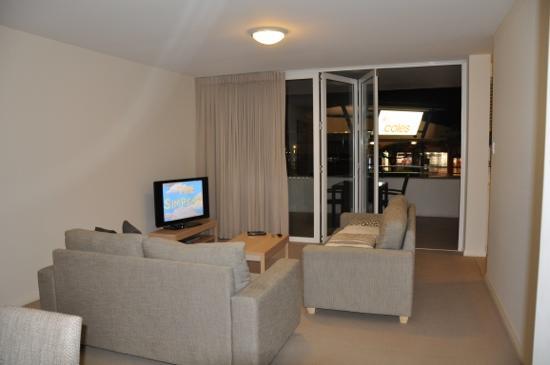 Domain Serviced Apartments : Family room and balcony