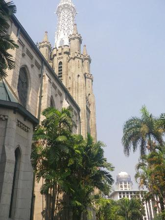 Jakarta Cathedral: A view of the church grounds with the State mosque in the background