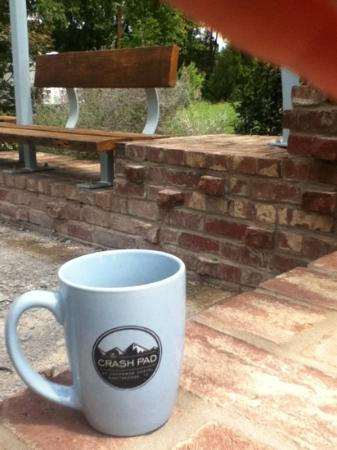 The Crash Pad: An Uncommon Hostel: a cup of joe on the patio