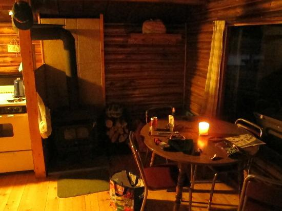 Postill Lake Lodge: Wood stove and eating area