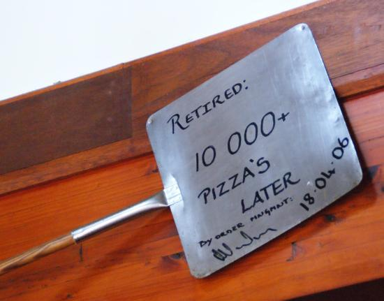 "Woodpecker Pizzadeli: This ""Pizza Shovel"" was displayed on the wall of the Swellendam Restaurant."