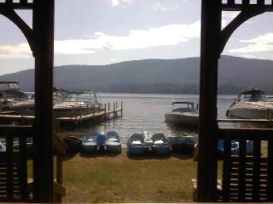 Marine Village Resort: view from gazebo out onto lake - see canoes/kayaks at shore, and guests' boats moored at pier