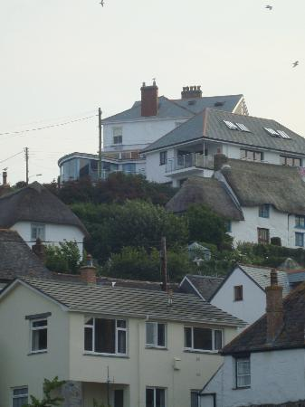 View from Coverack village up to Boak House - you can see the conservatory and deck at the top